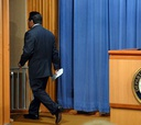 Alberto Gonzales walks away from the podium after delivering his statement of resignation Monday.