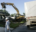 Contractors handle some of government's messiest tasks, such as Hurricane Katrina cleanup.
