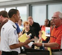 TSA workers meet with passengers at New York's John F. Kennedy Airport.