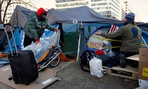 Occupiers pack up the morning of Jan. 30 in Farragut Square.