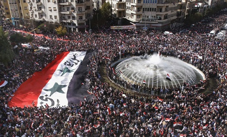 Syrians have protested in Damascus' main square.