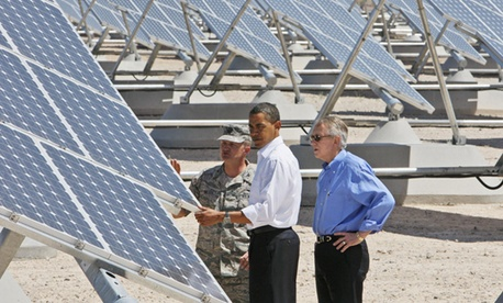 Flanked by Senate Majority Leader Harry Reid, D-Nev., and Col. Howard Belote, Obama examined solar energy at Las Vegas' Nellis Air Force Base in 2009.