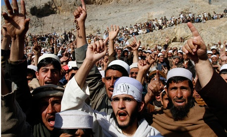 Afghans shout slogans during a protest in Ghani Khall.