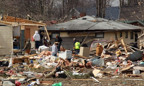 Residents assess tornado damage in Holton, Ind.