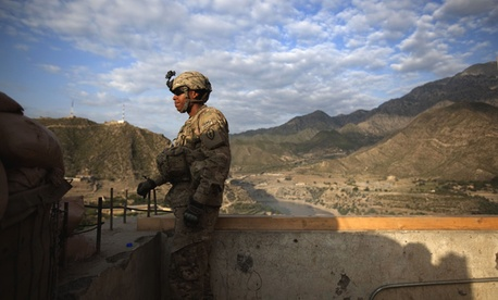 Pfc. Garrick Carlton keeps watch over an installment in Afghanistan.
