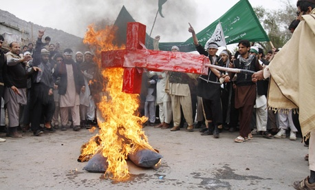 Afghans burn an effigy of Barack Obama following the killing of civilians by an Army staff sergeant.