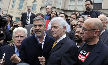 From left, Rep. Jim Moran, D-Va., actor George Clooney and journalist Nick Clooney were arrested after taking part in a protest at the Sudan Embassy in Washington