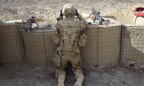 A U.S. soldier serves as a lookout near Afghanistan's Taba Kakar mountains.