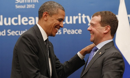 Barack Obama greets  Russian President Dmitry Medvedev at the summit.