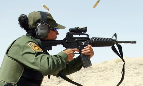 An agent practices at a U.S. Border Patrol firing range