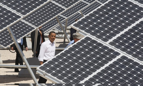 President Barack Obama looks at solar panels at Nevada's Nellis Air Force Base in 2009.