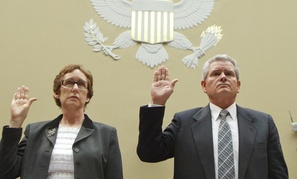 Former GSA Administrator Martha Johnson and Jeff Neely, a regional commissioner, are sworn in at a hearing Monday.