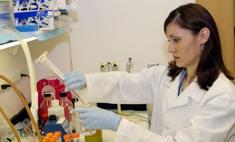 A biological technician works at a lab at the Centers for Disease Control