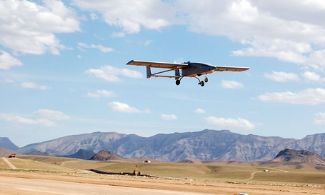 A TigerShark unmanned aerial vehicle descends to land at an undisclosed location following a mission.
