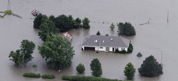A home is engulfed by flood water in Hamburg, Iowa from the rising Missouri River in 2011.