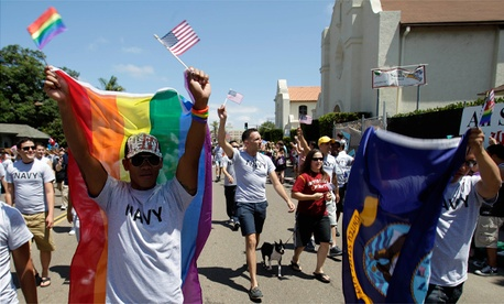 A former Navy sailor participates in a gay pride parade in San Diego.