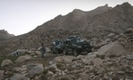Afghan police patrol mountains outside Kabul.