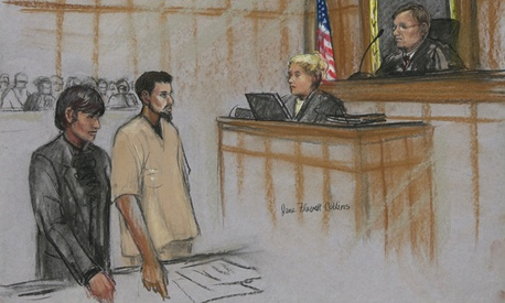  Rezwan Ferdaus, second left, and his attorney Catherine Byrne, left, stand during Ferdaus&#39; arraignment hearing in federal court in October.