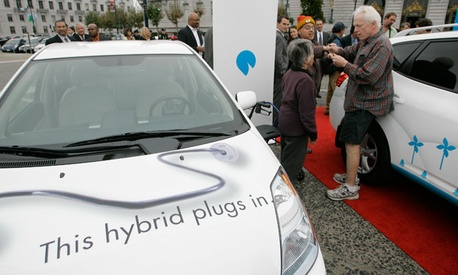 An electric car refuels at a charging station in San Francisco.