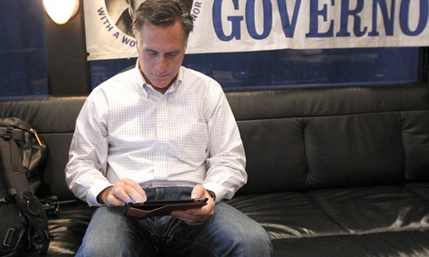 Mitt Romney uses his iPad on a bus tour in February.