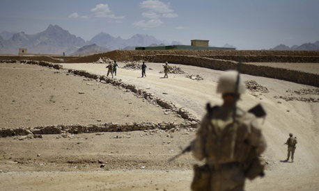 Afghan National police and U.S. Marines do a joint patrol through the town of Golestan in Afghanistan's Farah Province in 2009