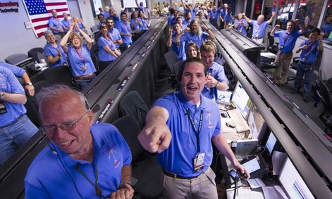 NASA/JPL ground controllers react to learning the Curiosity rover had landed safely on Mars.