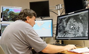 A senior hurricane specialist tracks Tropical Storm Isaac at the National Hurricane Center in Miami.