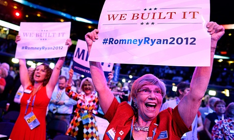 Georgia delegates Ruby Robinson, right, and Kathy Noble, left, hold up signs and cheer during the Republican National Convention in Tampa, Fla.