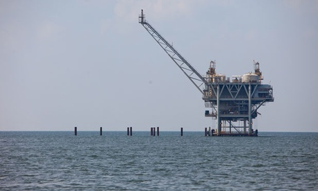 A rig extracts crude oil from the Gulf of Mexico in 2010.