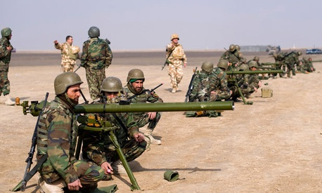 Afghan National Army soldiers practice emplacing a SPG-9 anti-tank weapon during weapons training at the Kabul Military Training Center in 2011.