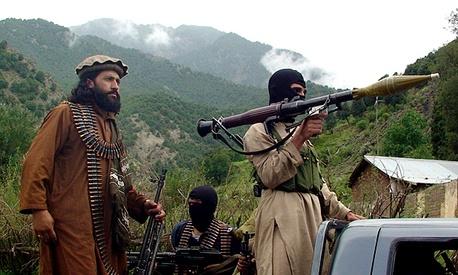Pakistani Taliban patrol in their stronghold of Shawal in Pakistani tribal region of South Waziristan.