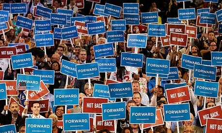 Delegates hold up signs at the Democratic National Convention in Charlotte, NC.