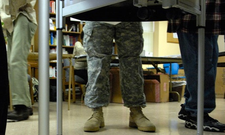 A soldier votes in 2008.