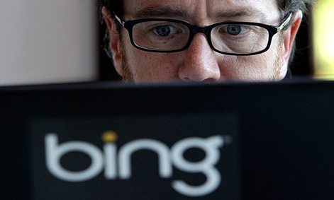 Microsoft vendor Patrick Porter works on a laptop marked with the logo for Bing, the company's search engine.