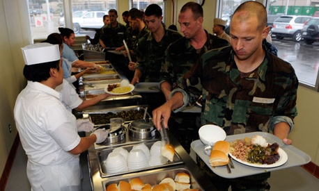 Sailors assigned to Basic Underwater Demolition/SEAL eat lunch on Naval Amphibious Base Coronado in 2010.