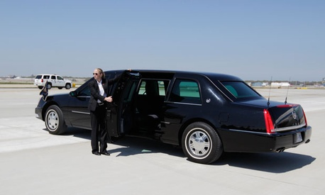 One of Obama's motorcade vehicles waits on a tarmac.