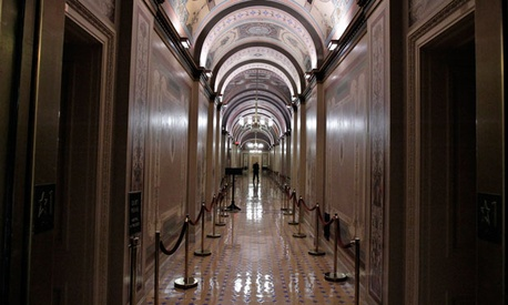 A worker walks the corridors of the United States Capitol.