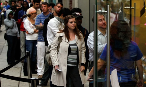 Customers wait in line to purchase the iPhone 4S in Oct. 2011.