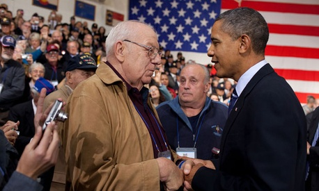 Obama meets with veterans at an event in 2010.