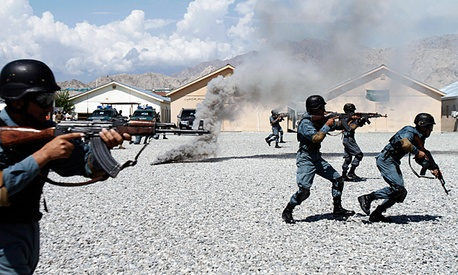 Newly graduated Afghan national police officers demonstrate their skills.