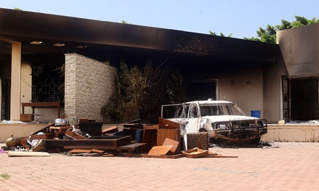 A burnt car stands in front of the U.S. Consulate in Benghazi after the attacks.
