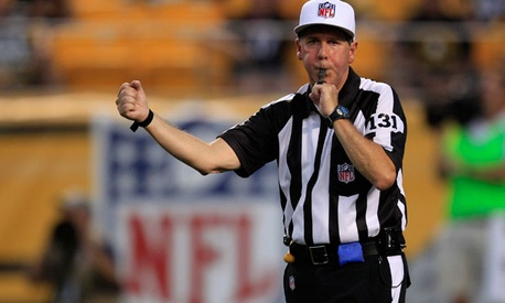 NFL replacement referee Jim Winterberg makes a call in a preseason game.