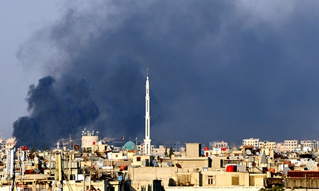 Smoke billows over Damascus.
