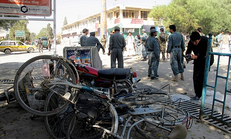 Afghan police secure the site of a suicide bombing in Khost, south of Kabul, Afghanistan.