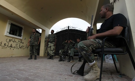 Security personnel stand guard outside the U.S. Consulate  in Benghazi in September.