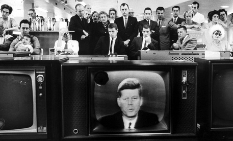 Customers in a California department store watch President Kennedy's televised address to the nation, as he informs the American people about the unfolding crisis in Cuba, October 22, 1962 Photograph by Ralph Crane