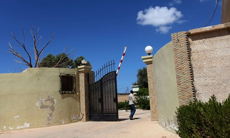 A man walks the grounds of the U.S. Consulate in Bengazi after the attack.