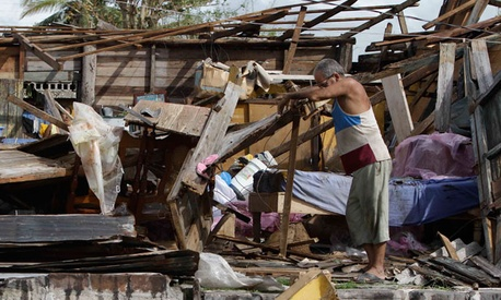 Resident Antonio Garces tries to recover his belongings from his house destroyed by Hurricane Sandy in Aguacate, Cuba, Thursday Oct. 25, 2012. Hurricane Sandy blasted across eastern Cuba on Thursday as a potent Category 2 storm and headed for the Bahamas