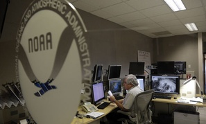 National Hurricane Center workers monitor the storm Friday.