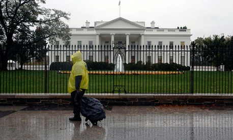 A lone pedestrian walks by the White House Monday afternoon as the storm hit.